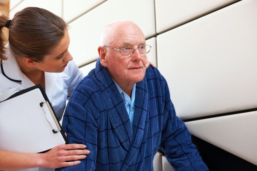 Manage Patient Elopement with a Real-Time Visibility Platform | Centrak | Young Professional helping an elderly man