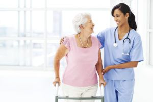 Assisted Living Wandering Residents – Reasons & Management | CenTrak | Staff Helping Elderly